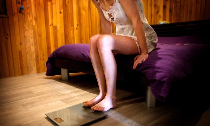 Reportage on a woman suffering from anorexia. Christel, 32, has suffered from anorexia for 2 years. Her body mass index (BMI) is 16.7 and is extremely thin. The first thing she does every day is weigh herself. (Photo by: BSIP/UIG via Getty Images)