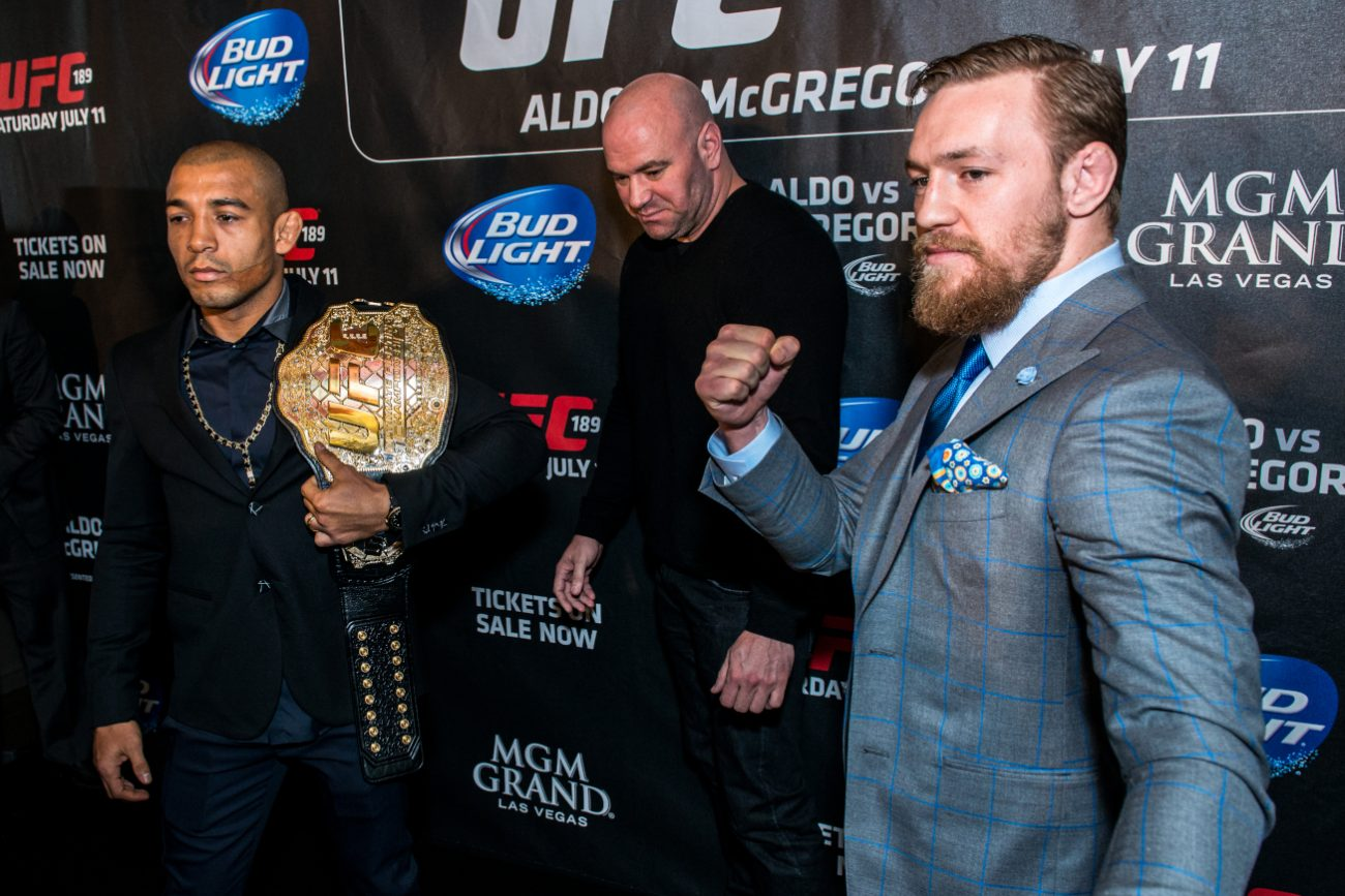 "José_Aldo_vs._Conor_McGregor,_UFC_189_World_Tour_London Di Andrius Petrucenia on Flickr (Original version)UCinternational (Crop) - Originally posted to Flickr as ""UFC 189 World Tour Aldo vs. McGregor London 2015""Cropped by UCinternational, CC BY-SA 2.0, Andrius Petrucenia on Flickr (Original version)"